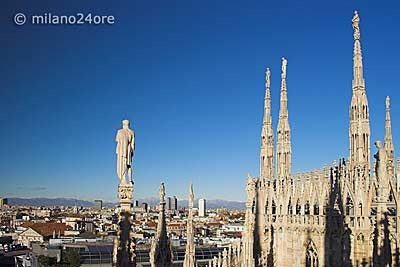 View from cathedral roof over Milan to the Swiss Alps